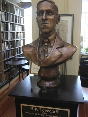 A portrait bust of horror and fantasy writer H.P. Lovecraft greets visitors to the Providence Athenaeum. A statue of the Providence native by a local artist has been commissioned and awaits a permanent home.