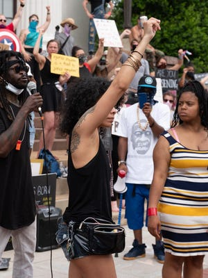 Angela Colon (center, with fist raised) of the Wilmington Advocacy and Protest Organization, or WAPO, at a protest in downtown Wilmington on June 6.
