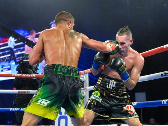 Vasiliy Lomachenko left, lands a punch to the face of Jose Pedraza in lightweight boxing match at Madison Square Garden, Saturday, Dec. 8, 2018, in New York. (AP Photo/Howard Simmons)