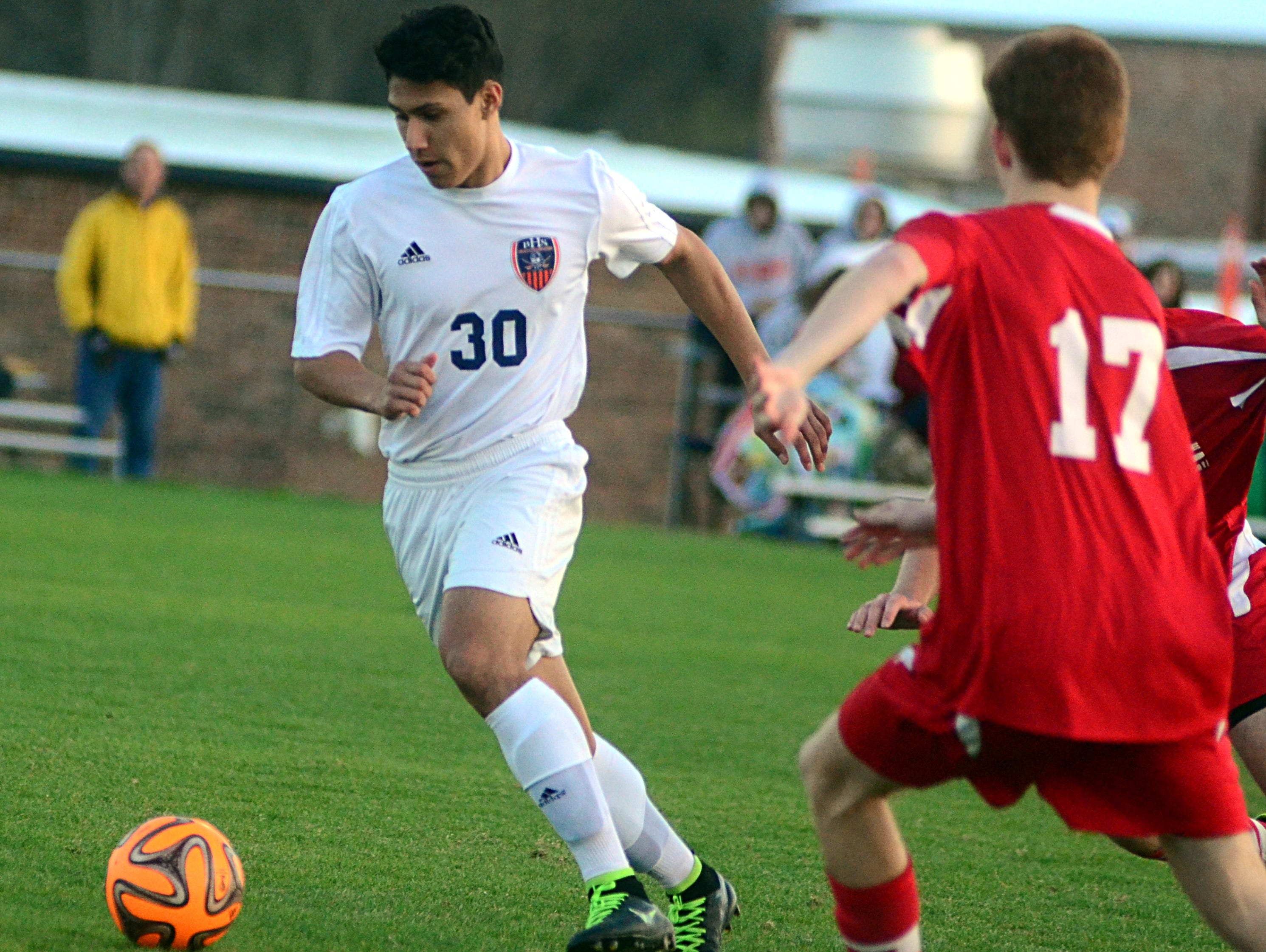 Beech High junior Lorenzo Huerta gains possession as Middle Tennessee Fire junior Parker Miller converges during first-half action.