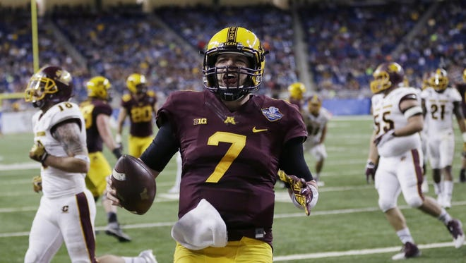 Minnesota quarterback Mitch Leidner celebrates after outrunning the Central Michigan defense for the go-ahead touchdown during the Quick Lane Bowl game on Dec. 28, 2015, in Detroit.