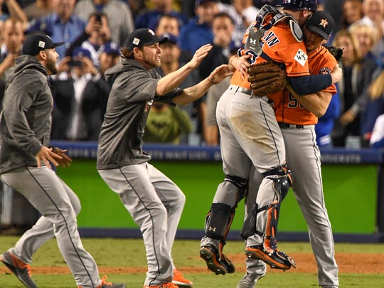 The Houston Astros celebrate after beating the Los