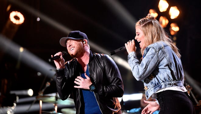 Cole Swindell performs with Lauren Alaina at Nissan Stadium on the first day of CMA Fest 2017, on Thursday, June 8, 2017, in Nashville.