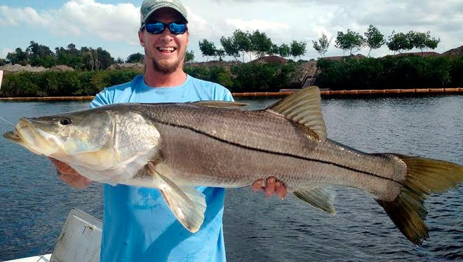 Brian Cloy is rightfully smiling, he wrote, after the Greek sea god Poseiden finally smiled on him after 20 years of snook fishing. He caught this 44-inch monster on a small thread herring in an Estero pit mine he and friends call Jurassic Park.