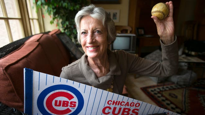 Sue Quigg, 77, of Phoenix, will throw out the first pitch at the Cubs and Diamondbacks game at Wrigley Field on April 23, 2014, using the same ball that her grandmother used to throw out a first pitch during a baseball game in 1914 during the inaugural season of what is now Wrigley Field. Quigg is seen with that baseball at her home on Friday, April 18, 2014.