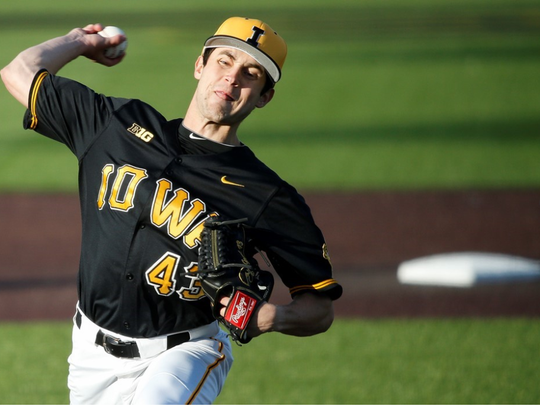 Grant Leonard delivers a pitch during Iowa's 6-4 win