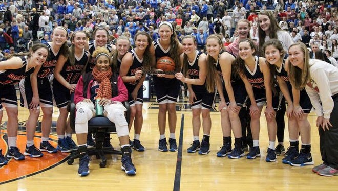 Roncalli's girls basketball team pose after winning Saturday's regional final.
