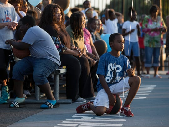 Members of the Asbury Park community come together at the Donald Hammary Basketball Courts to remember the life of James Famularo who lost his life in a fire this past week. Asbury Park, NJThursday, July 12, 2018@Hood73