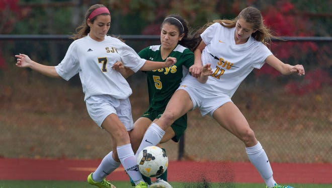 St. John Vianney's Meagan Urbealis and Katie DiFrancisco block out Red Bank Catholic's Emily Leniart during first half action.  Red Bank Catholic vs St. John Vianney in NJSIAA State Soccer tournament