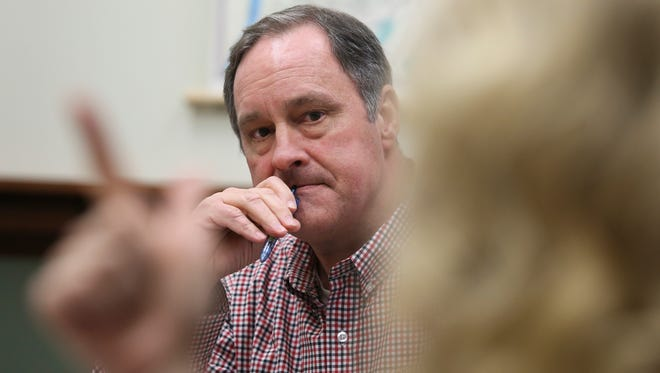 Metro Councilman Robin Engel, R-22nd District, listens to a colleague during a caucus meeting. Jan. 6, 2015
