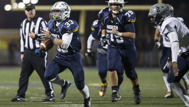 Toms River North senior running back Parker Day  (No. 33) has averaged almost 10 yards a carry this season.
