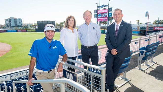 Bubba Watson, left to right, Rishy Studer, Quint Studer, and Jonathan Griffith, at Blue Wahoos stadium in Pensacola on Friday, March 31, 2017.