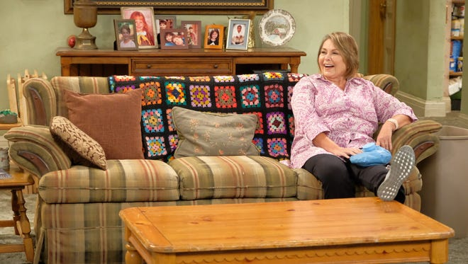 "Roseanne (Roseanne Barr) sits alone on the Conner family couch on ABC's ""Roseanne."""