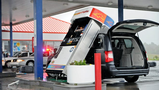 Fuel pumps were blown over at a truck stop Tuesday, Oct. 7, 2014, in Maysville, Ky.,  following high winds and heavy rain. (AP Photo/The Ledger-Independent, Terry Prather)
