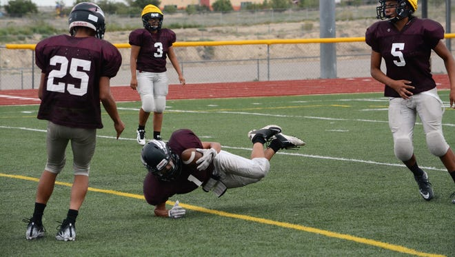 Shiprock's Tyrell Bruce makes a one-handed catch for a touchdown at practice on Aug. 15. The Chieftain open the season 7 p.m. Friday at home against Red Mesa, Ariz.