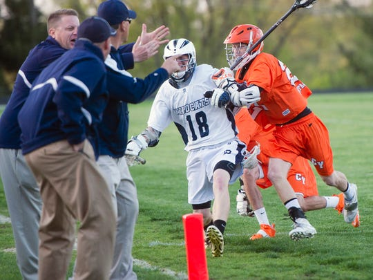 Dallastown's Grant Duvall (18) and Central York's CJ Belker battle near the sideline Friday during the Panthers' 11-9 win. (Daily Record/Sunday News -- Paul Kuehnel)