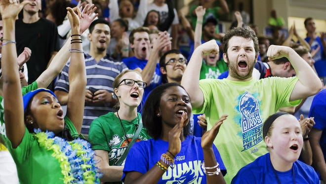 What's it like to be a Dirty Bird at an FGCU basketball game in Alico Arena? The News-Press' Janine Zeitlin, second row center, found out recently when Dirty Bird leaders Jacob Barrett, right, and Jasmine Lugg, left, took her under their wings during FGCU's game against Kennesaw.