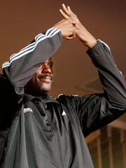 Shaquille O'Neal points to his ring finger as the Suns fans give his a standing ovation during a break in the action in Phoenix on Feb. 5, 2008.