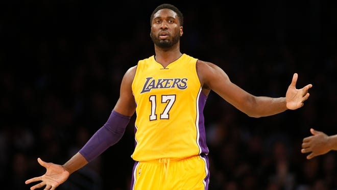 Los Angeles Lakers' Roy Hibbert celebrates on the court against the Dallas Mavericks during the first half of an NBA basketball game, Tuesday, Jan. 26, 2016, in Los Angeles. (AP Photo/Danny Moloshok)