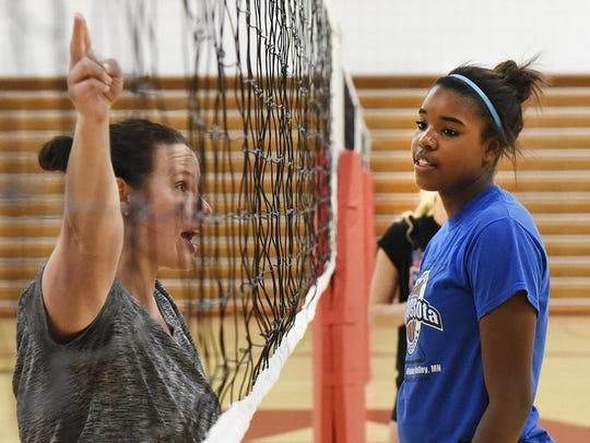 Annandale's Kamryn D'Heilly listens as coach Michelle