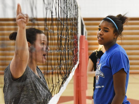 Annandale's Kamryn D'Heilly listens as coach Michelle Macalena explains the next drill during practice Wednesday in Annandale.