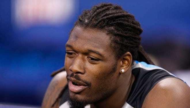 South Carolina Gamecocks defensive end Jadeveon Clowney sits on the bench during the 2014 NFL Combine at Lucas Oil Stadium on Feb. 24, 2014.