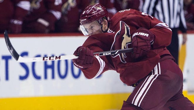 The Coyotes' Connor Murphy scores his first NHL goal against the Lightning at Jobing.com Arena on Nov. 16, 2013.