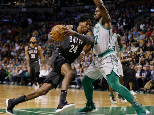 Brooklyn Nets forward Rondae Hollis-Jefferson (24) drives to the basket against Boston Celtics forward Semi Ojeleye (37) during the first half of an NBA basketball game Wednesday, April 11, 2018, in Boston. (AP Photo/Elise Amendola)