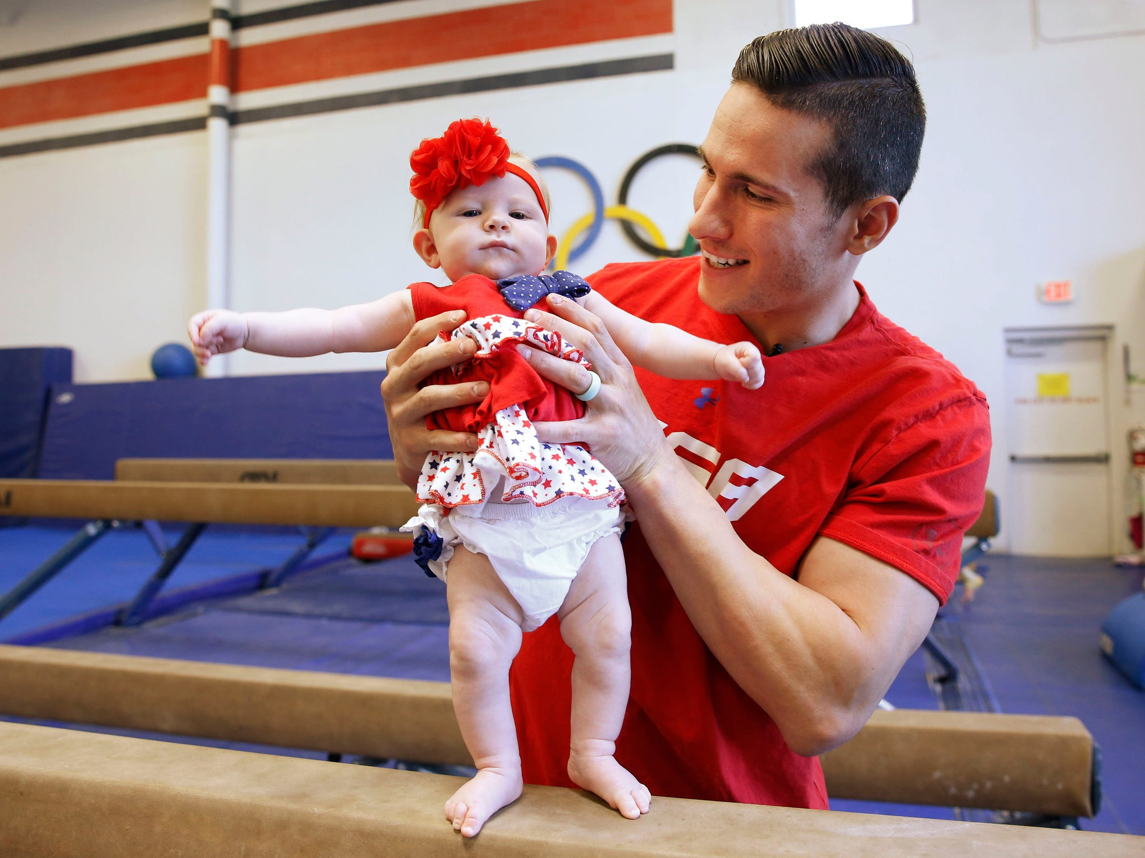 Olympic gymnast Alex Naddour plays with 3-month-old