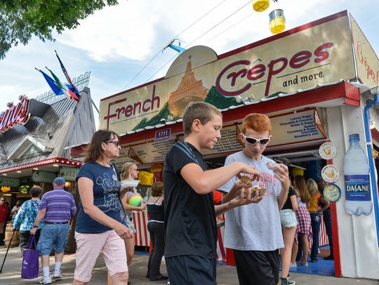 Fair-goers try foods in the midst of the Minnesota State Fair in this 2016 Times photo.