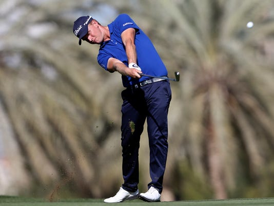 Morten Madsen of Denmark plays a ball on the 14th hole during round three of the Dubai Desert Classic golf tournament in Dubai, United Arab Emirates, Saturday, Jan. 31, 2015. (AP Photo/Kamran Jebreili)