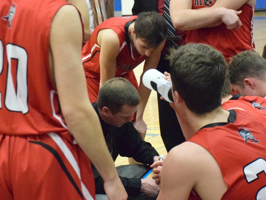 Riverheads head coach Chad Coffey diagrams a play for