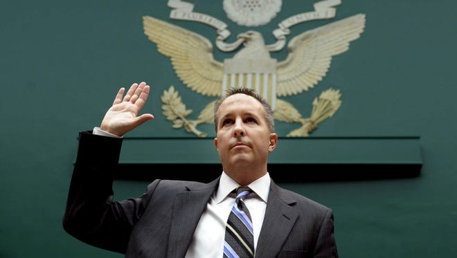 Barry Cadden of New England Compounding Center is sworn in on Capitol Hill in Washington on Nov. 14, 2012.