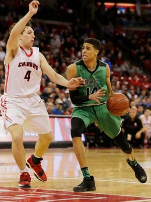 Oshkosh North's Tyrese Haliburton gets past Hamilton's Lucas Finnessy during the second half of a WIAA Division 1 boys basketball semi-final at the Kohl Center in Madison.