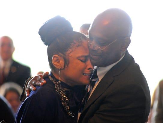 Renee Ellis is hugged by her husband Dr. Cedric Ellis