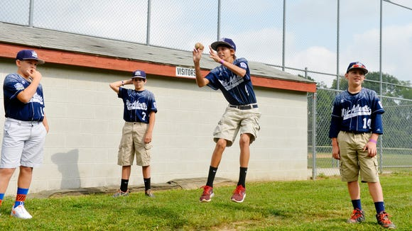 From left, Red Land Little League's Dylan Rodenhaber, Jake Cubbler, Braden Kolmansberger and Jarrett Wisman goof around playing hot potato before their hometown parade celebration Saturday, Sept. 5, 2015, at the Newberry Baseball Complex in Newberry Township. One week after Red Land won the Little League World Series U.S. championship, local municipalities and businesses teamed up to organize a hometown celebration.