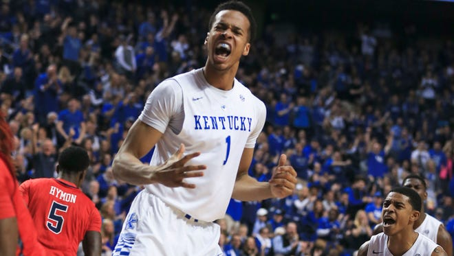 Kentucky's Skal Labissiere yelled in celebration after a dunk during the Wildcats easy win over Ole Miss Saturday night at Rupp Arena. The freshman finished with nine points and three rebounds.