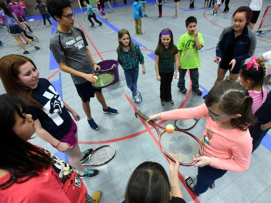 Members of the Piedra Vista High School boys and girls tennis teams lead an exercise on Wednesday during a free tennis camp at the Boys and Girls Clubs of Farmington.