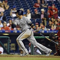 Aramis Ramirez of the Milwaukee Brewers hits an RBI single during the eighth inning against the Philadelphia Phillies on Tuesday.