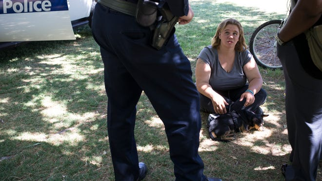 Stephanie Jones, who is homeless, is approached by Phoenix police officers at Margaret T. Hance Park. The officers offer Jones assistance, part of a program called the Misdemeanor Repeat Offender Program, designed to reduce the city's homeless population.