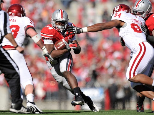 COLUMBUS, OH - NOVEMBER 5:  Carlos Hyde #34 of the Ohio State Buckeyes runs up the middle for yardage against the Indiana Hoosiers at Ohio Stadium on November 5, 2011 in Columbus, Ohio. Ohio State defeated Indiana 34-20.  (Photo by Jamie Sabau/Getty Images)
