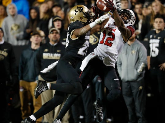 Utah wide receiver Tim Patrick, right, pulls in a pass as Colorado defensive back Ahkello Witherspoon defends in the second half of an NCAA college football game Saturday, Nov. 26, 2016, in Boulder, Colo. Colorado won 27-22. (AP Photo/David Zalubowski)