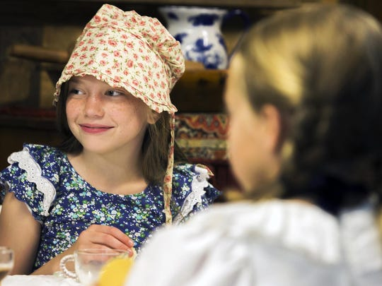 Maggie Few dresses in pioneer style for the final day of Heritage Camp recently at Cannonsburgh Village in Murfreesboro.