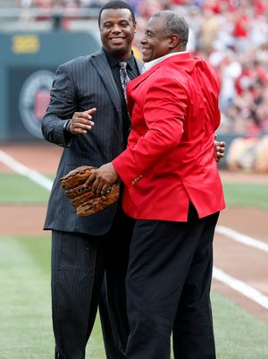 Reds Hall of Famer Ken Griffey Sr. (right) embraces his son, Ken Jr., during his son's Reds Hall of Fame induction ceremony last August.