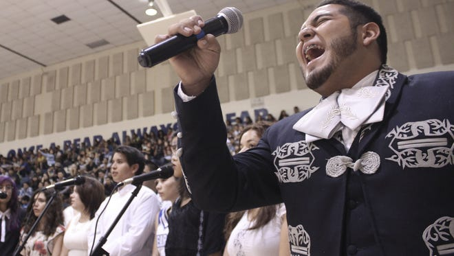 Bowie senior Brian Gomez, the lead singer of the school's mariachi ensemble, performs in front of the crowd during the Meet the Bears assembly Sept. 2 at Bowie High School's main gym.
