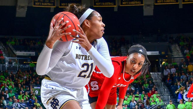 Notre Dame Fighting Irish forward Kristina Nelson (21) grabs a rebound in front of North Carolina State Wolfpack forward Chelsea Nelson (5) in the first half at the Purcell Pavilion.