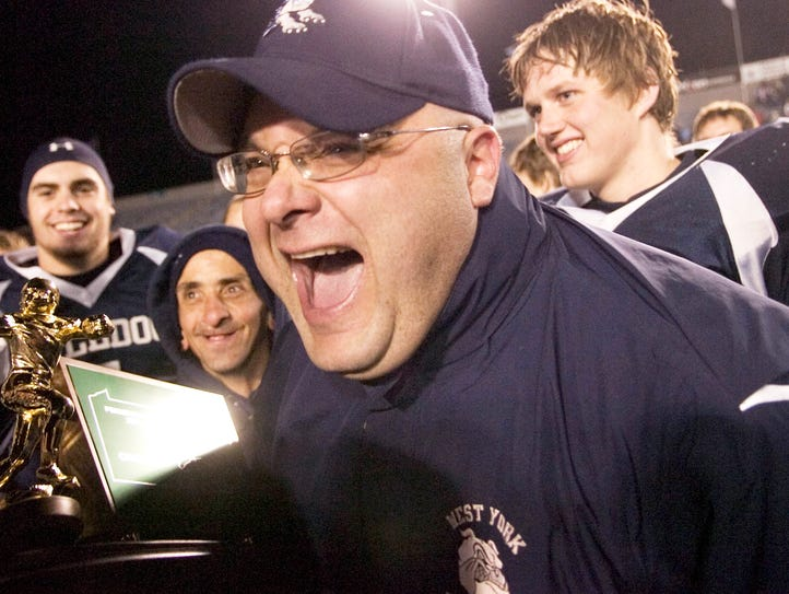 Ron Miller celebrates after the Bulldogs defeated Manheim