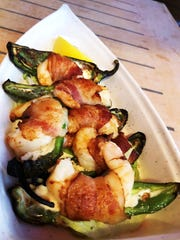 The bacon-wrapped shrimp jalapeños at Mango's Dockside