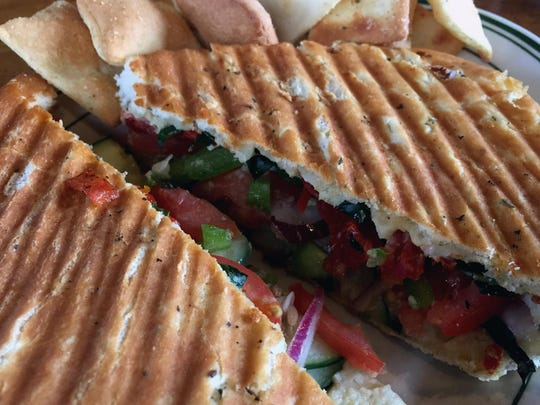 The Toasty Vegan panino is swiped with hummus and punched up with roasted garlic and sun-dried tomatoes.