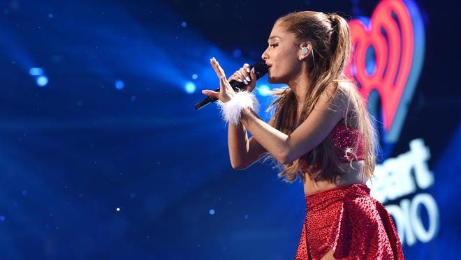 Ariana Grande performs at the KIIS FM's Jingle Ball at the Staples Center on Friday, Dec. 5, 2014, in Los Angeles.
